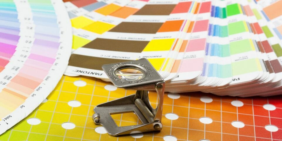 Pantone colour swatch and magnifying glass